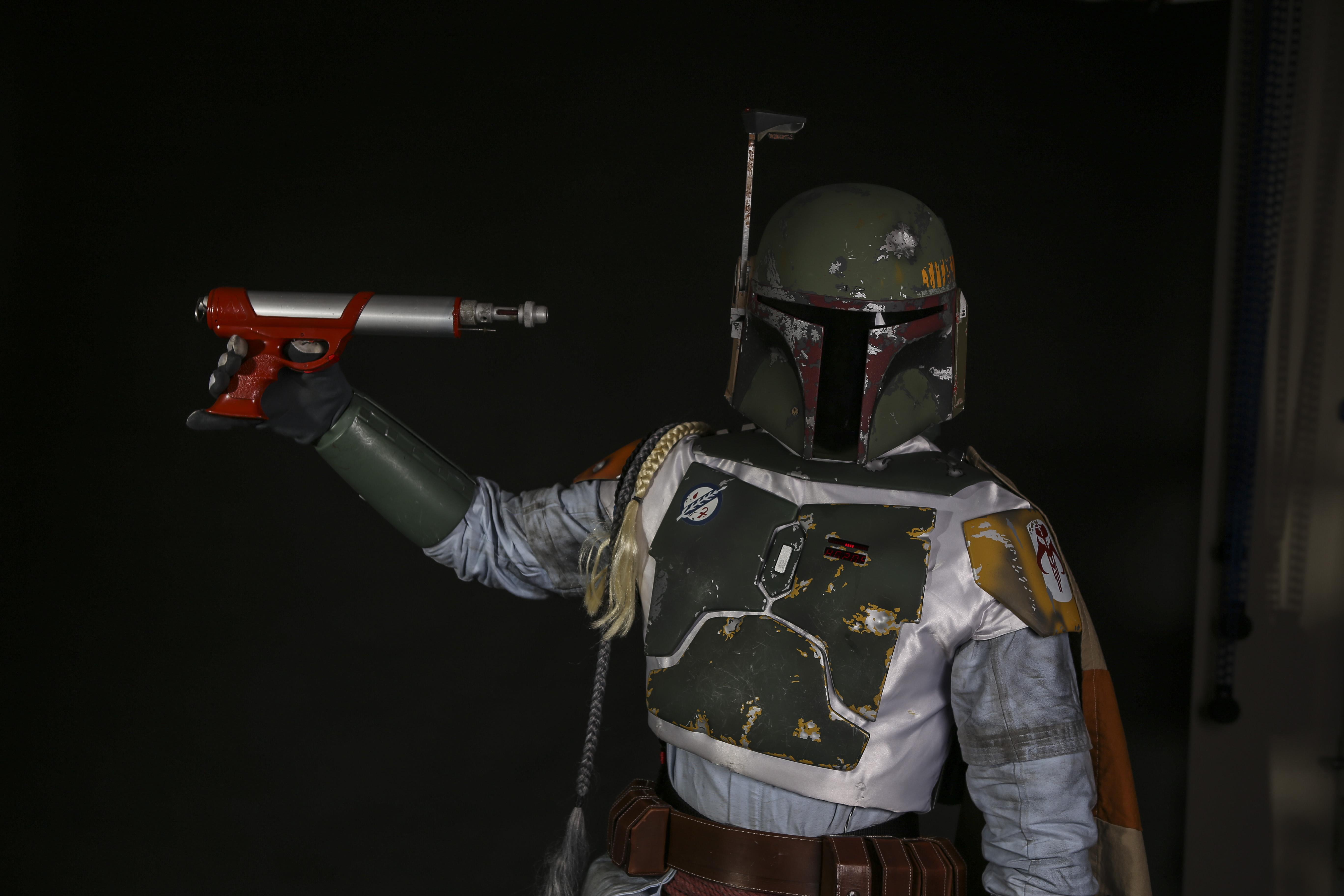 Boba Fett holding a blaster